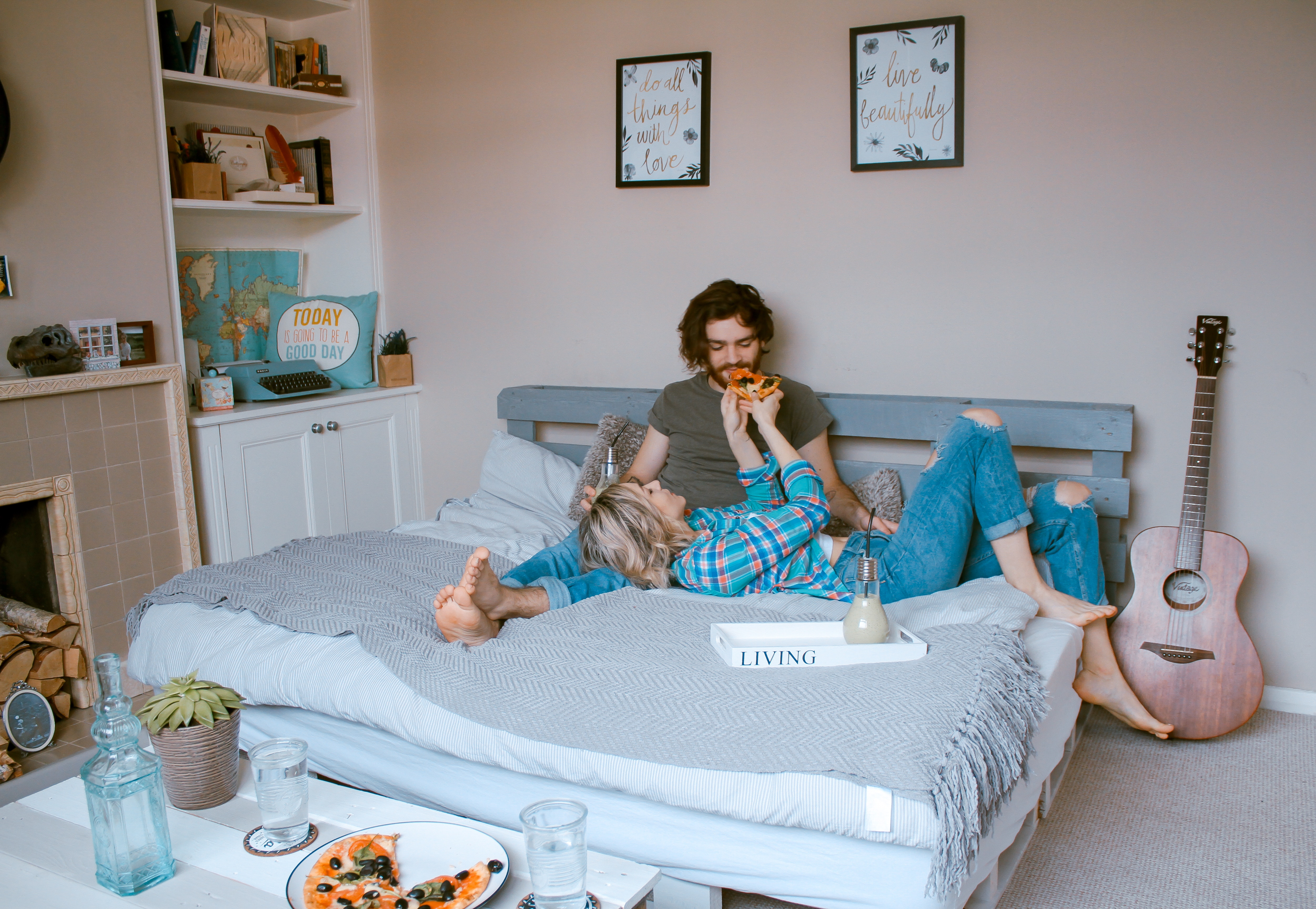 couple taking breakfast in bed